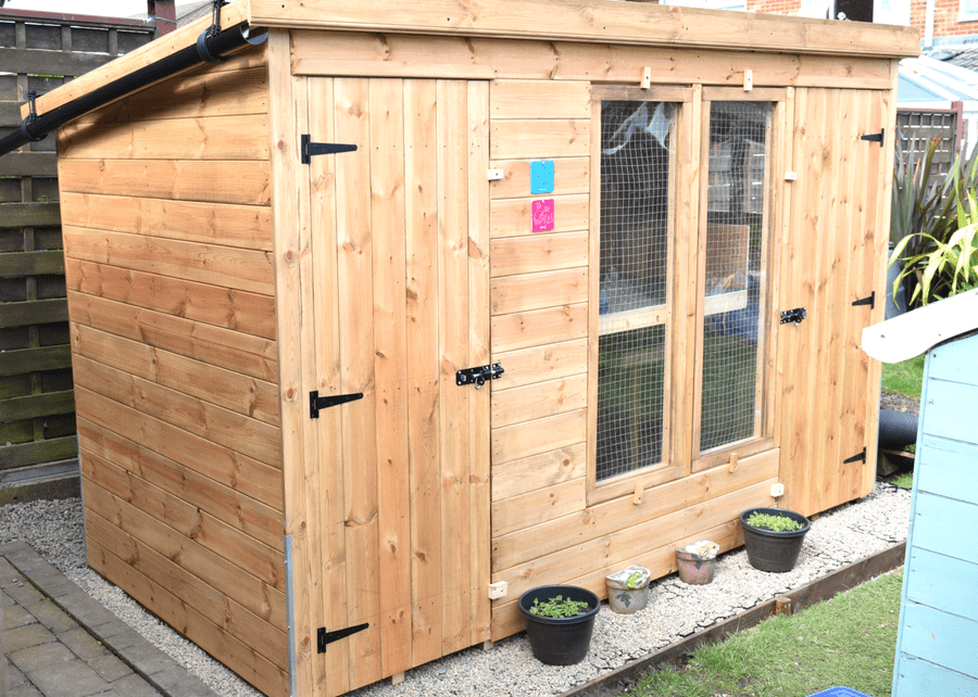 Plastic Shed Base Used Under a Rabbit Kennel And Run Featured Image