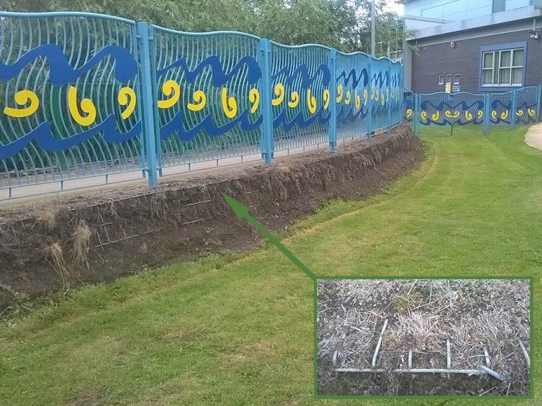 Rubber Grass Mats Covering A Soil Bank - Before Grass Mats Installed w Close Up