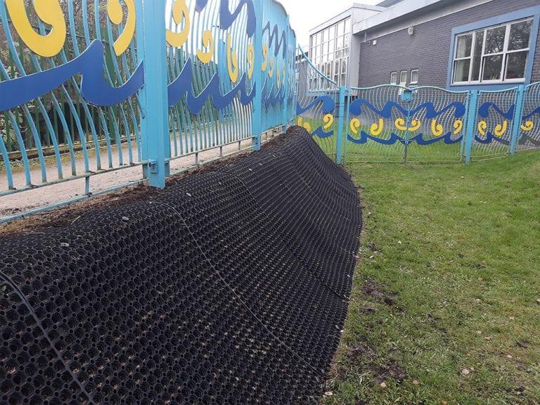 Rubber Grass Mats Covering A Soil Bank - Grass Mats Installed