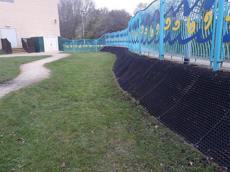 Rubber Grass Mats Covering A Soil Bank - Rubber Grass Mats Installed