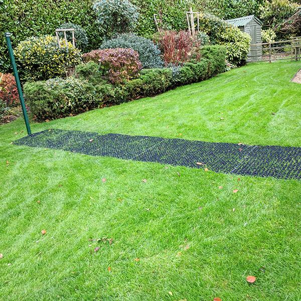 Rubber Grass Mats Under Washing Line