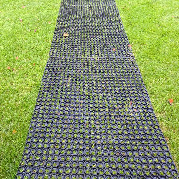 Rubber Grass Mats Under Washing Line1