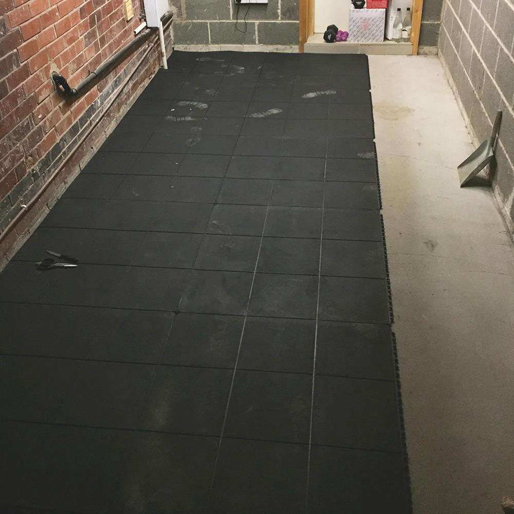 Rubber-Gym-Mats-Installed-In-Garage