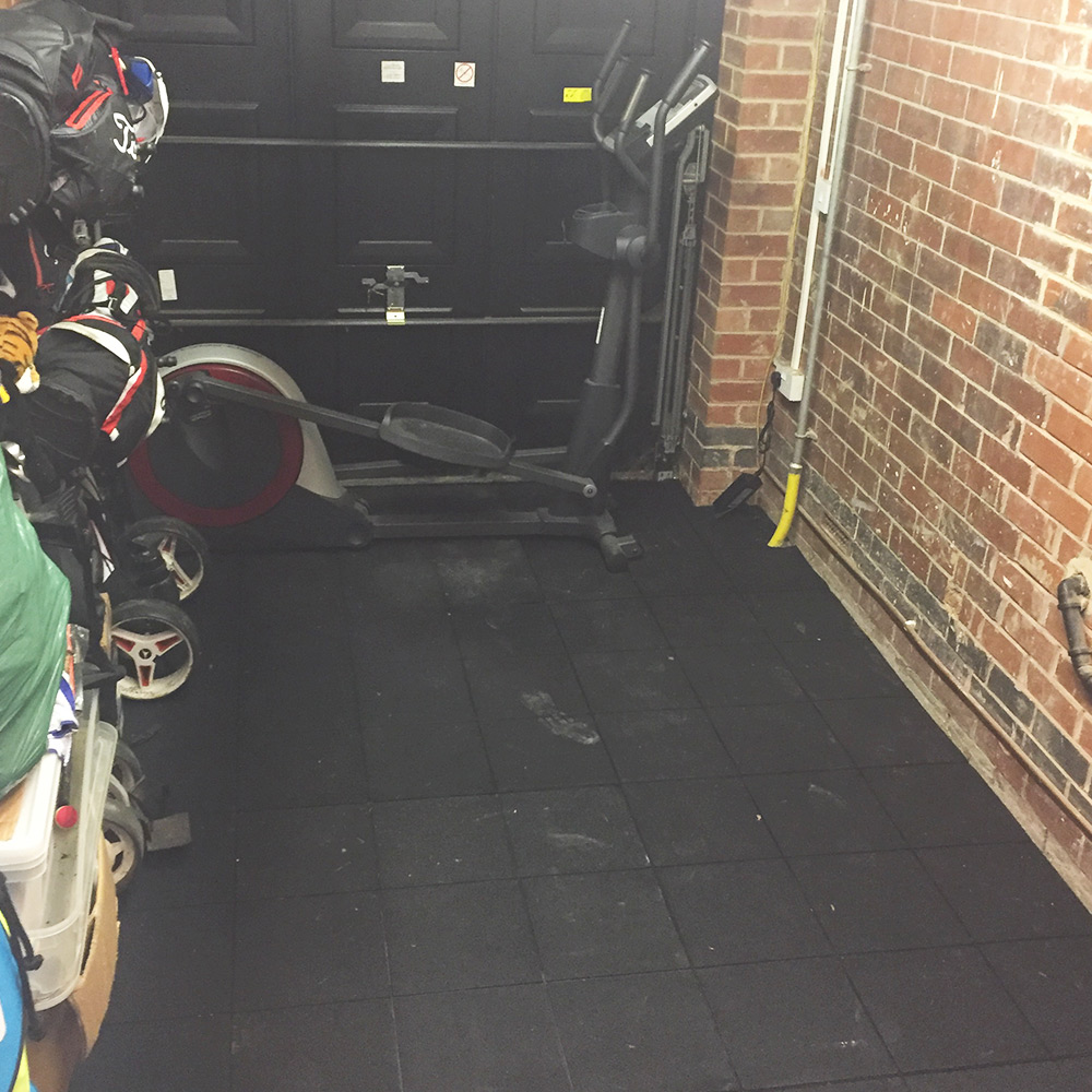 Rubber-Gym-Mats-Installed-In-Garage-With-Exercise-Bike