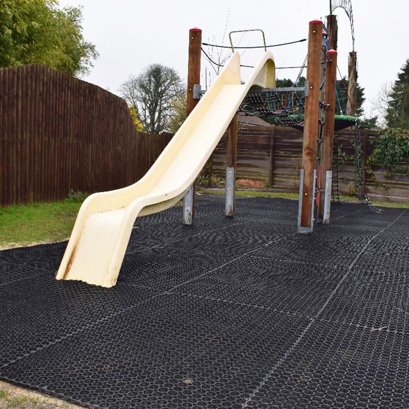 Rubber Grass Mats Under The Living Rainforest's Play Area - Slide
