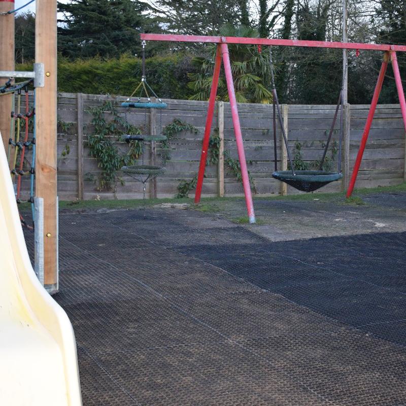 Rubber Grass Mats Under The Living Rainforest's Play Area - Swings & Slide