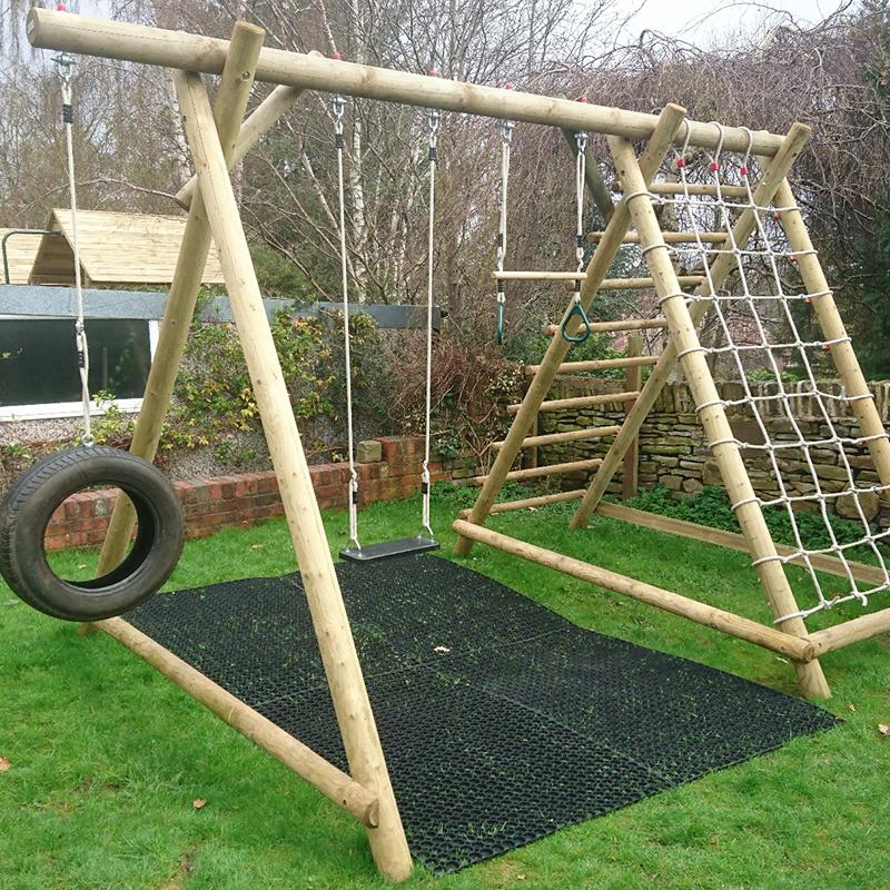 Rubber Grass Mats Installed Under A Caledonia Play Swing Set - Choosing Grass Mats