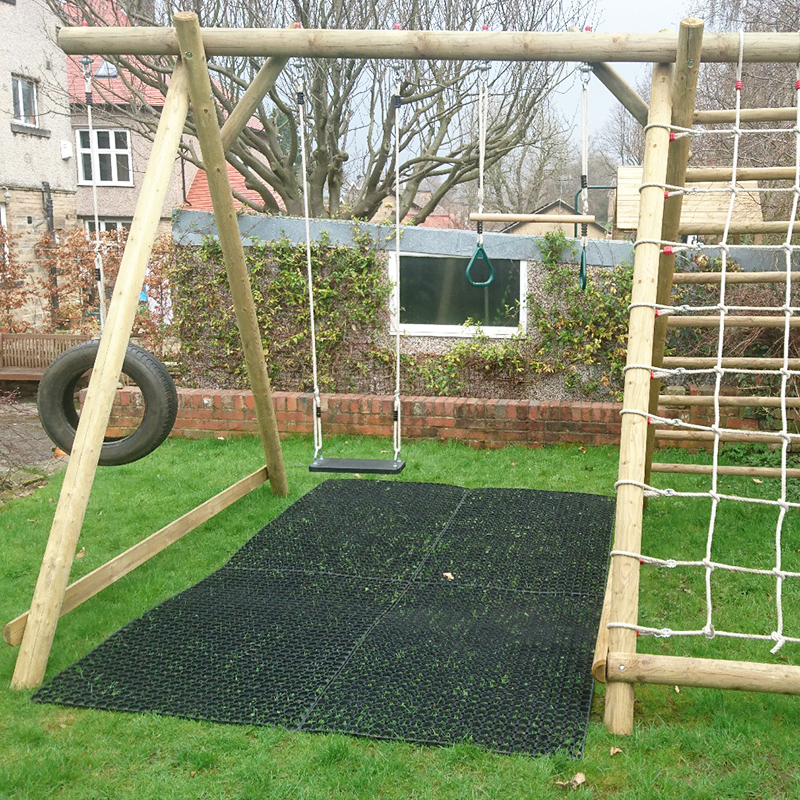 Rubber Grass Mats Installed Under A Caledonia Play Swing Set - Installing