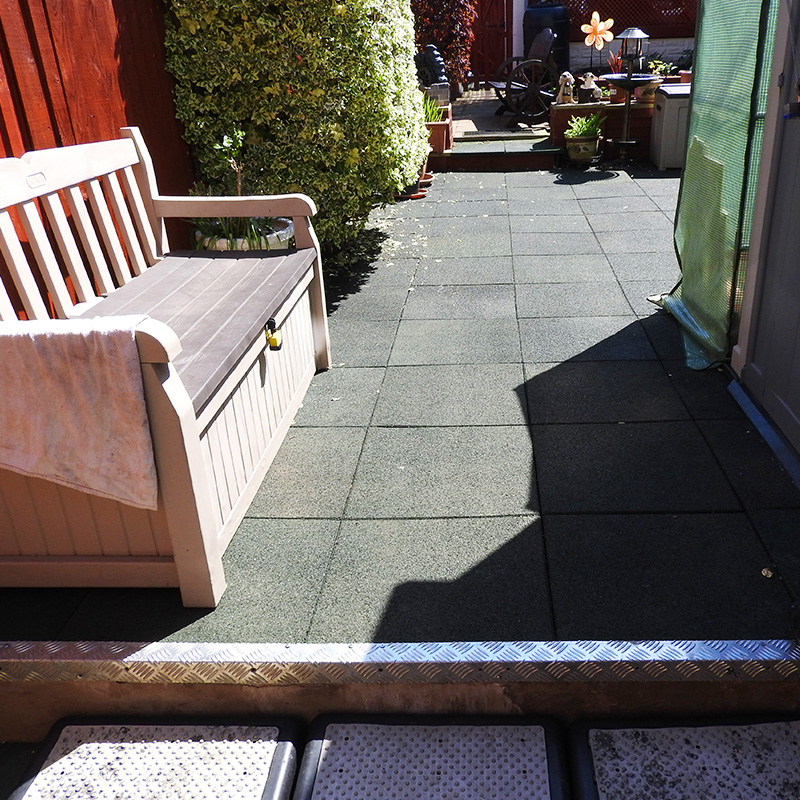 Rubber Tiles Used To Pave A Backgarden - Image1
