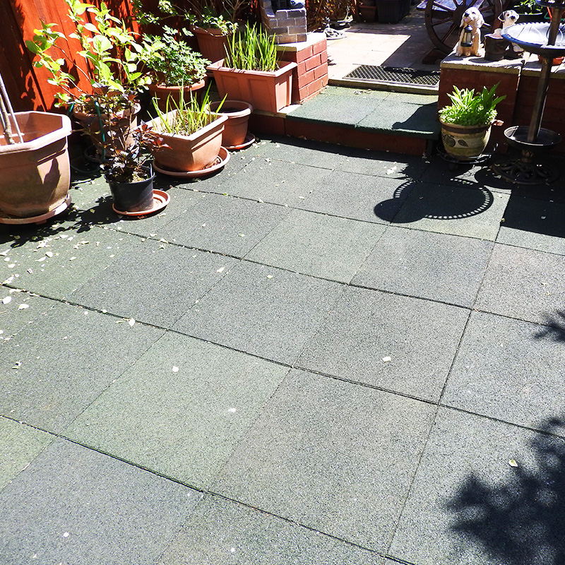 Rubber Tiles Used To Pave A Backgarden - Image2