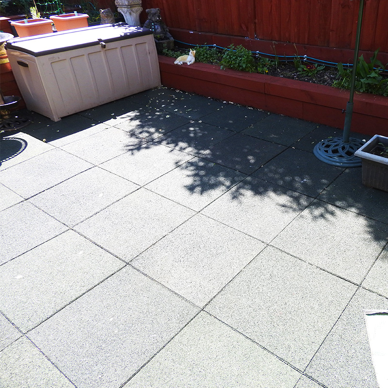 Rubber Tiles Used To Pave A Backgarden - Image3