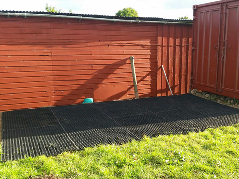 Grass Mats Behind Shipping Container In Horse Paddock -Image 4