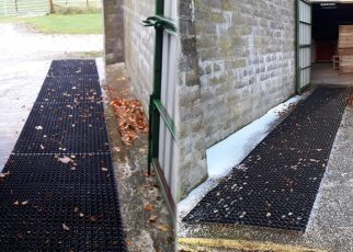 Grass Mats Used To Create A Non-Slip Path Over Concrete For Ponies - Featured Image