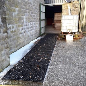 Grass Mats Used To Create A Non-Slip Path Over Icy Concrete For Ponies
