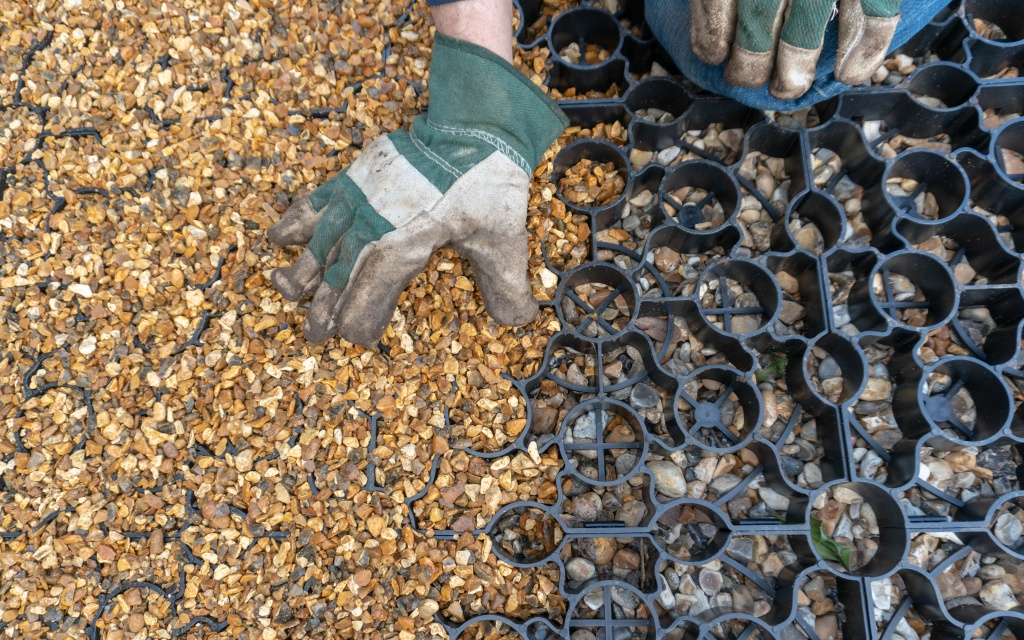 11.-Plastic-Shed-Base-Installation-Filling-Base-With-Gravel