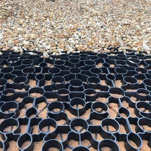 Laying-Gravel-Driveway-Using-Black-X-Grid