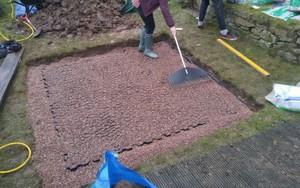 Gravel being raked over 6ft x 6ft Hot Tub Base