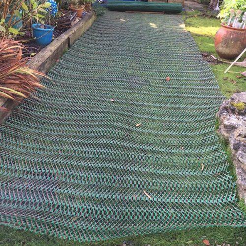 Grass-Reinforcement-Mesh-On-Garden---Mesh-Being-Installed