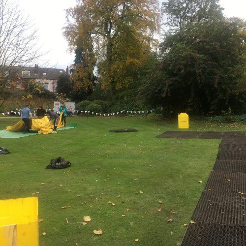 Rubber Grass Mats Being Installed - Illuminate The Gardens