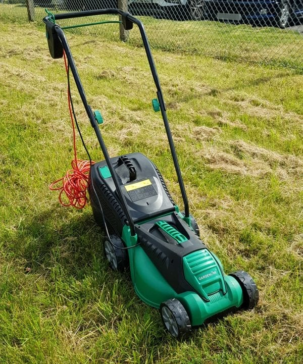 1200w lawnmower on grass verge